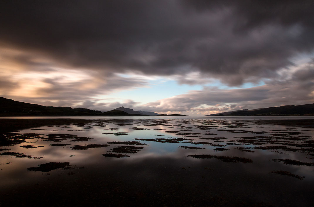 Sunset Isle of Skye, Scotland at a bay with mystic blue and grey colors and reflection in the water, 1280x844px