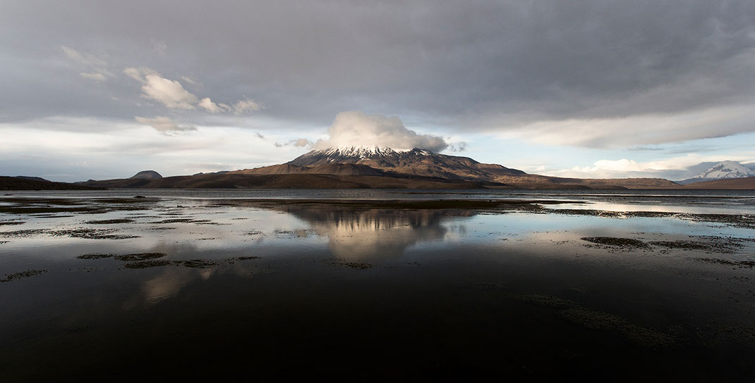 Summit of Parinacota Vulcam covered with a cloud, Putre in Parque Lauca, Andes, Chile 1280x651px