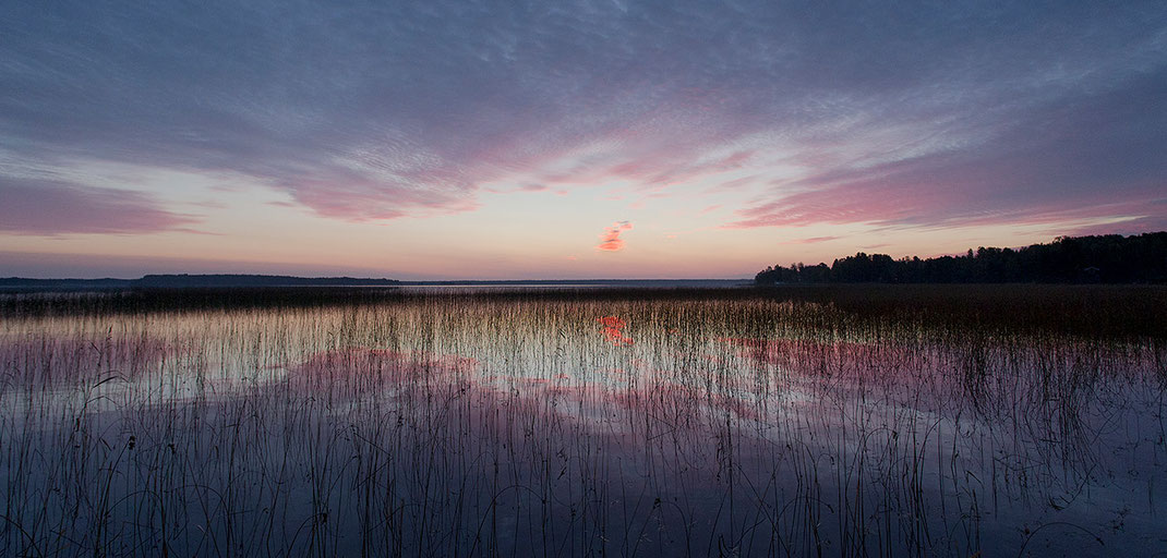 Sun rising at a lake in Gaevle, Sweden, Scandinavia with beautiful warm colors