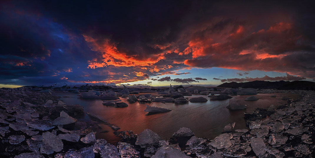 Jokulsarlon Glacier Lagoon sunset with beautiful dramatic red sky and ice along the shore, Austurland, Iceland