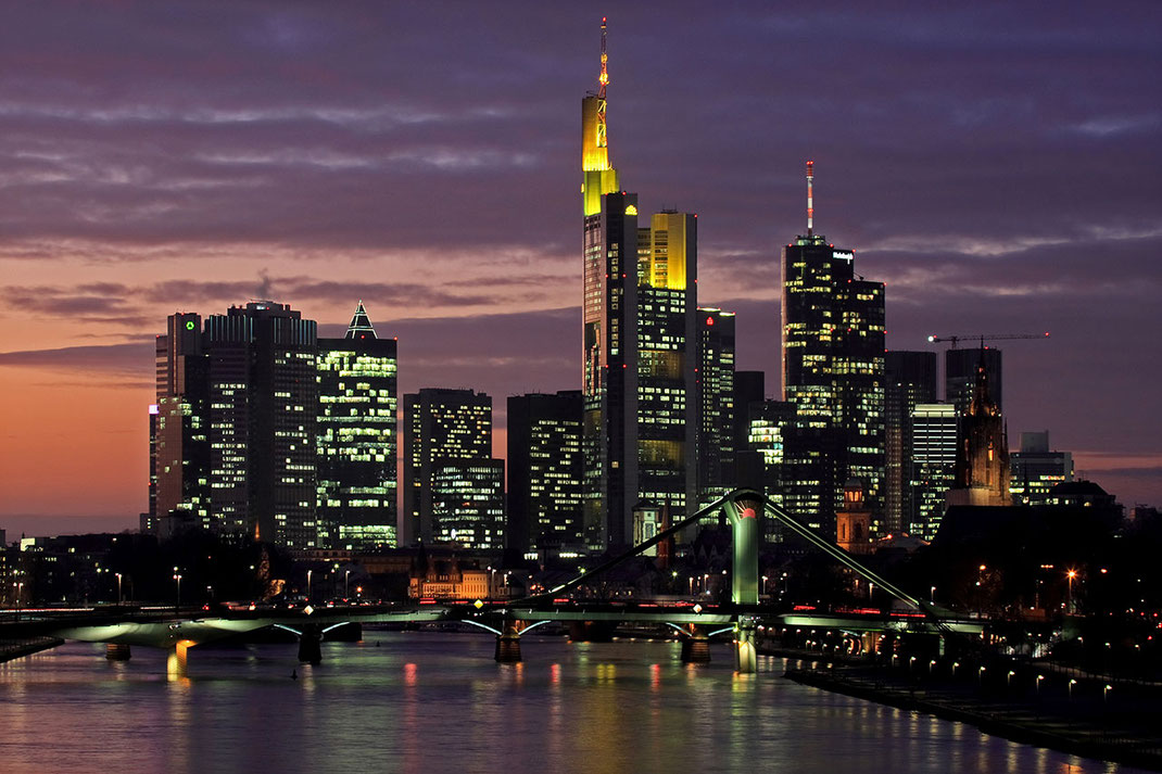 Frankfurt Skyline with Main river after sunset with purple color in the sky, long exposure, Hessen, Germany