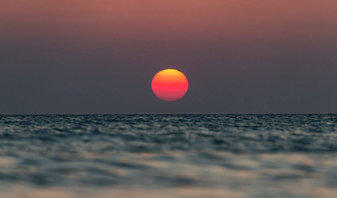 Beautiful Red sun setting in the Gulf of Mexico, Island Holbox, Yucatan Peninsula, Mexico, 1280x752px