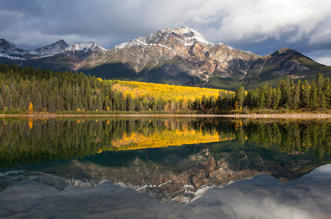 Beautiful yellow larch trees with Pyramid mountain reflecting in Patricia lake, Japer National Park, Alberta, Canada, 1280x848px