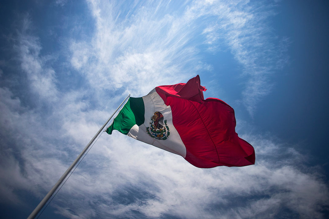 Giant Mexican Flag and blue sky at a central place in Pueblo, Mexico, 1280x853px