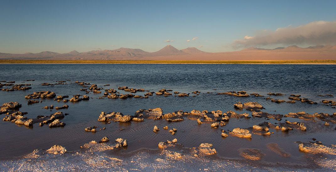 Laguna Piedra in the late warm sunset light with salt crust, San Pedro de Atacama, Desert Chile, 1280x657px