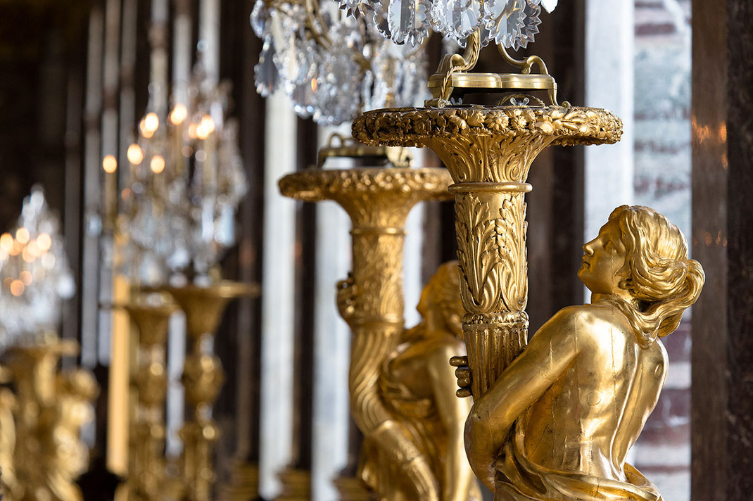 Golden sculptures in the Versailles Palace, Paris, France