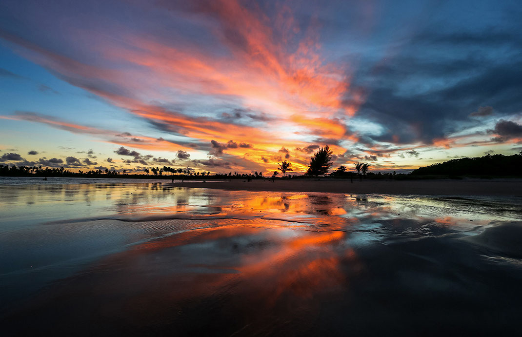 Colorful and beautiful sunset at a beach with red and blue reflections in the water, Maceio, Brazil, 1280x827px