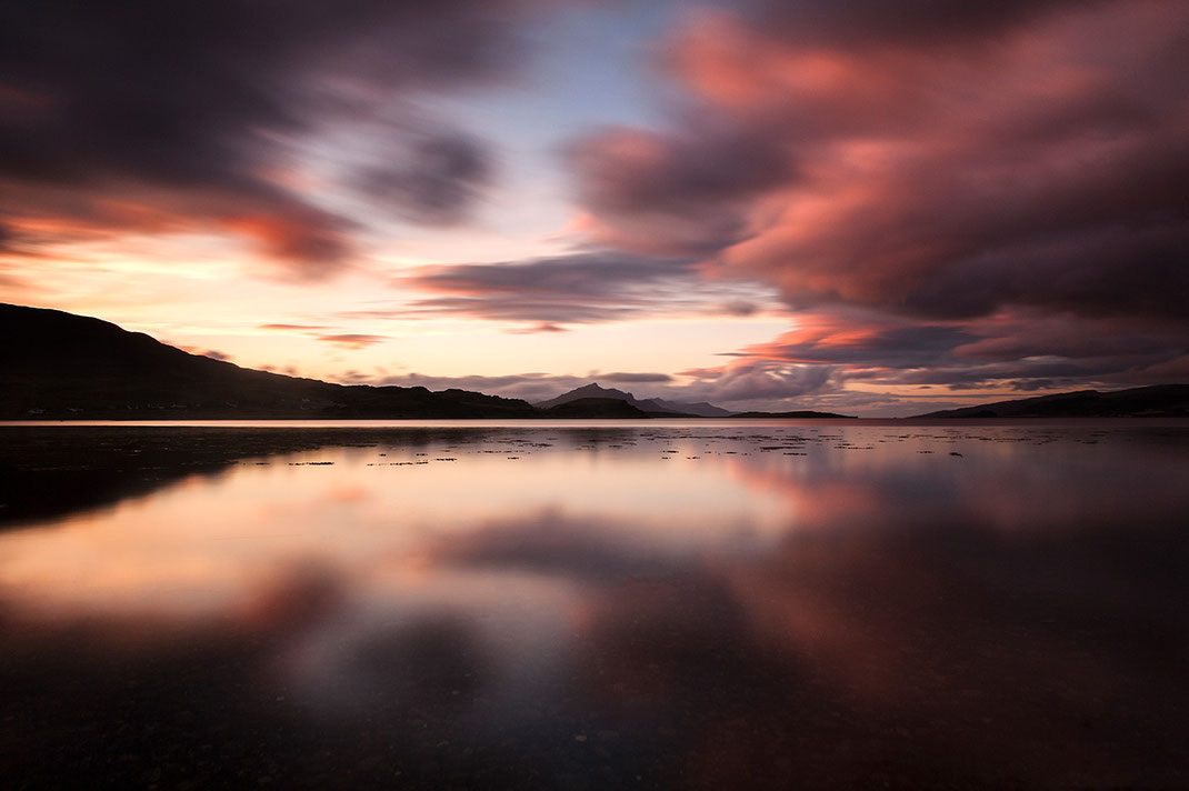 Sunset Isle of Skye, Scotland at a bay with beautiful red colors, mountains and reflections in the water, 1280x852px