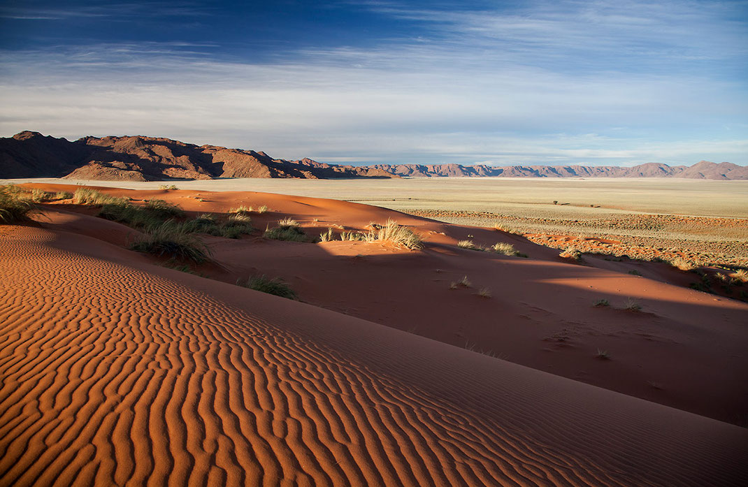 Beautiful red sand dunes in the Namib Desert surrounded by mountains, Namib Naukluft Park, Namibia, 1280x834px