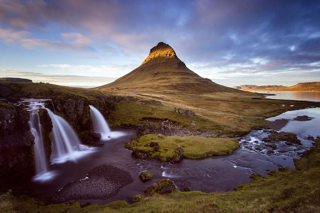 Remarkable shaped Kirkjufell rock surrounded by waterfalls in sunset light,Snaefellsnes, Iceland