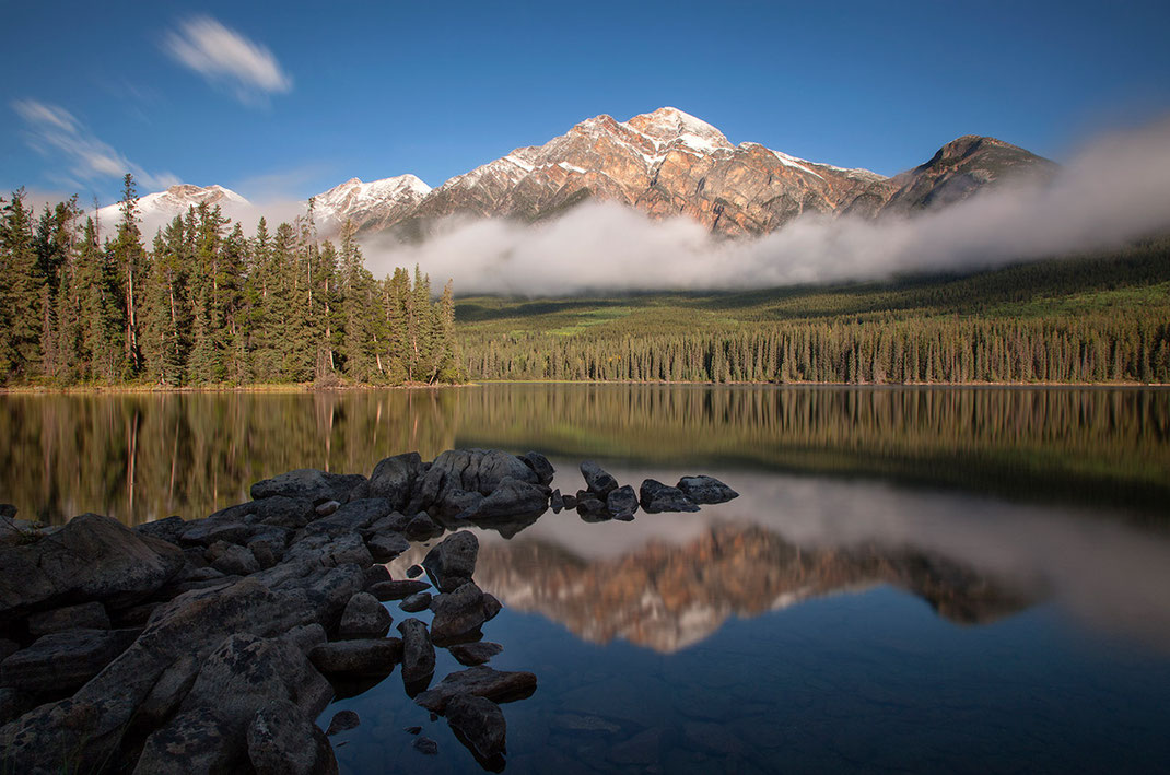 Beautiful Pyramid lake with clouds in sunshine and reflections, long exposure, Japer National Park, Alberta, Canada, 1280x848px