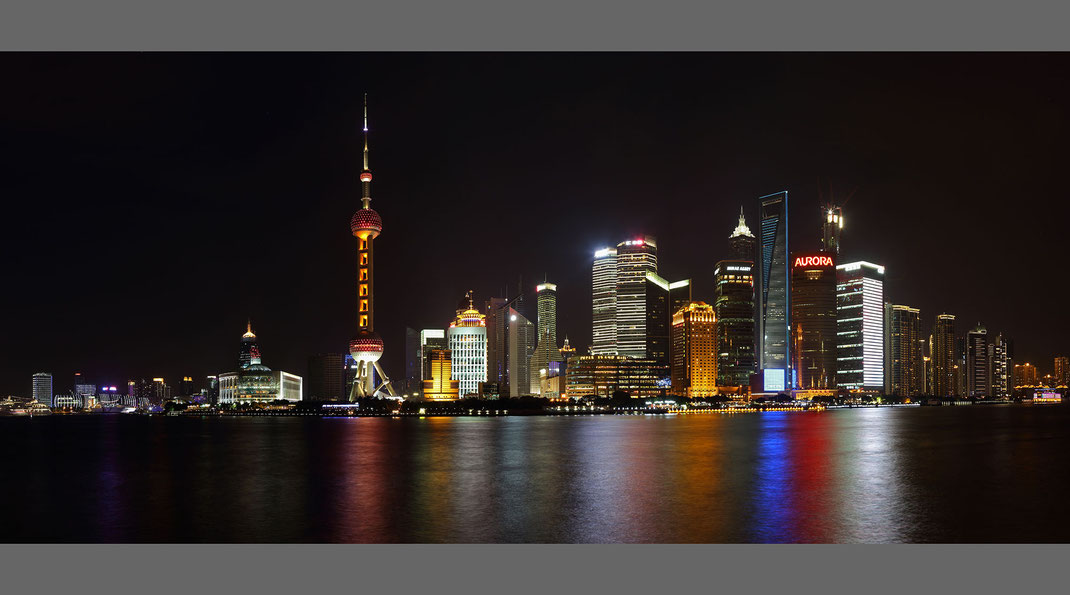 Beautiful illuminated Sanghai Pudong Skyline Skyscrapers at night with river in front, China, 2000x1113px