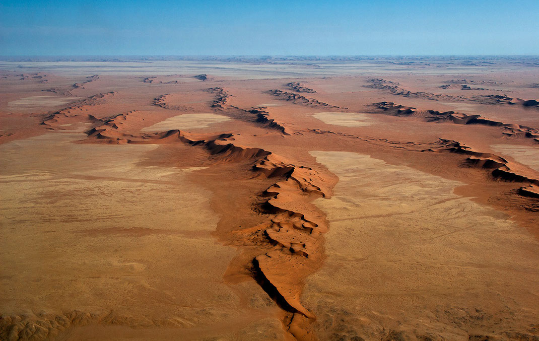 Orange sand dunes as seen from the air in a shape like Africa, Namib Naukluft Park, Namibia, 1280x810px