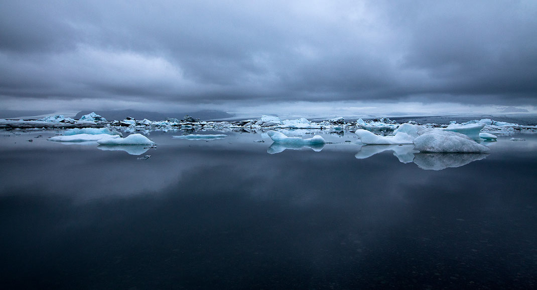 Ice floating on a Glacier Lagoon with blue cold colors, Austurland, Iceland