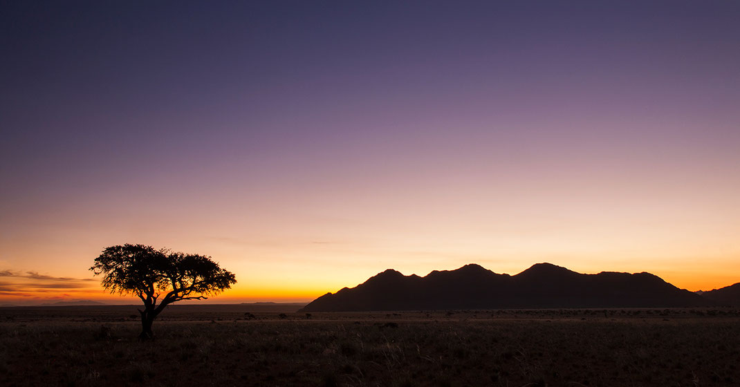 Beautiful and magic sunset with orange, pink and purple colors, Namib Naukluft Park, Namibia, 1280x670px