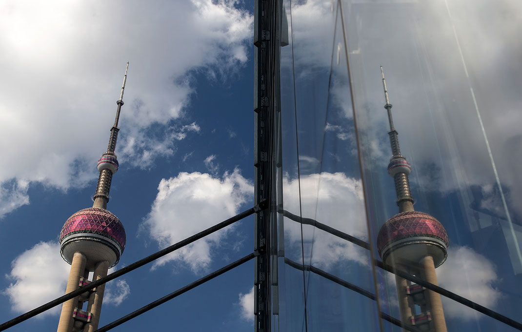 Shanghai skyline with pearl tower skyscraper and a reflection in a window, China, 1280x815px