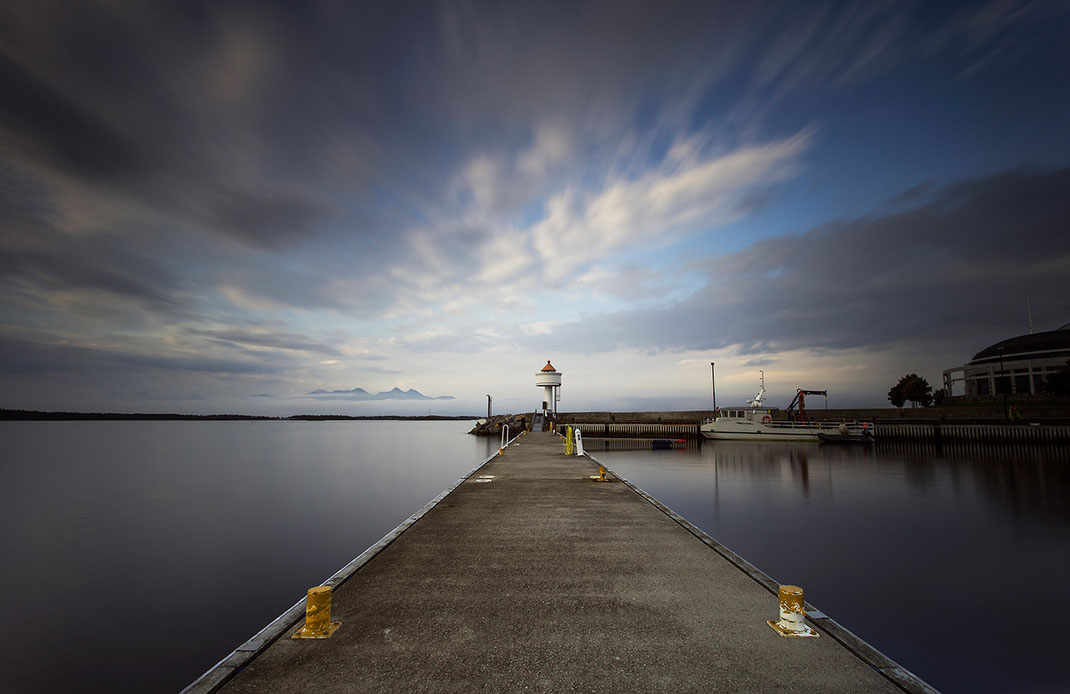 Lighthouse and pier with smooth ocean and mountains, long exposure, Molde , Norway, 1280x830px
