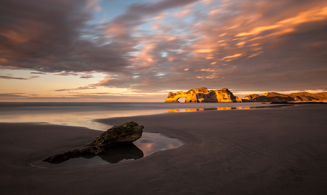 Wharariki Beach beautiful Sunset with glowing rocks, Cape Farewell, Southern Island, New Zealand, 1280x765px