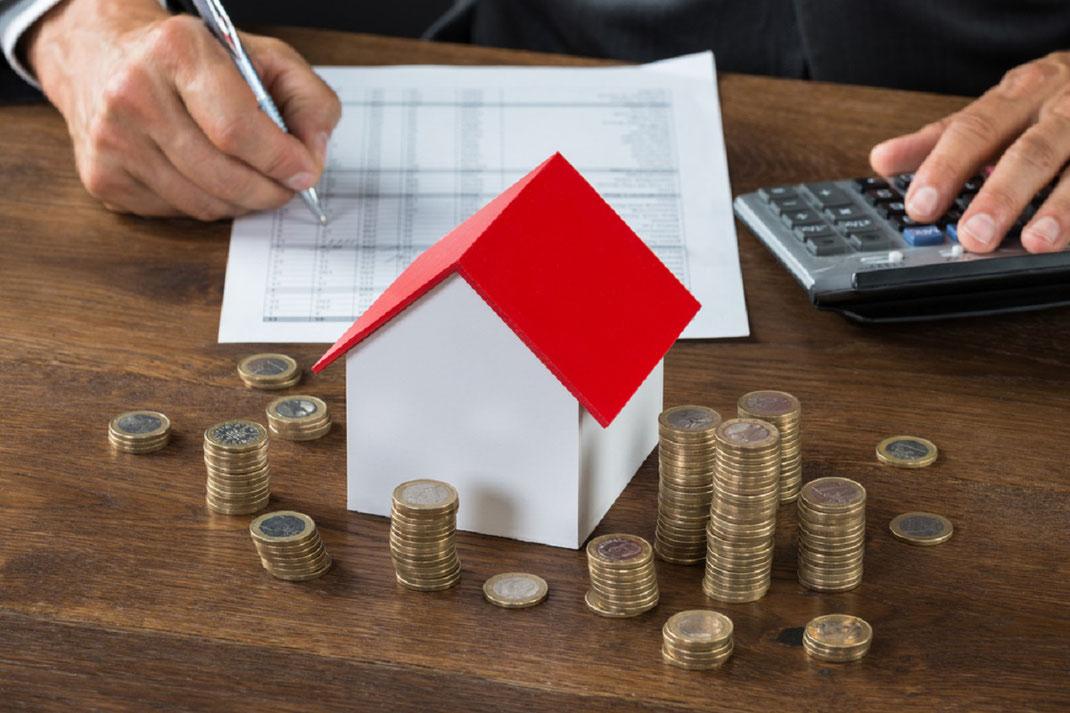 Impuestos a pagar al comprar una casa