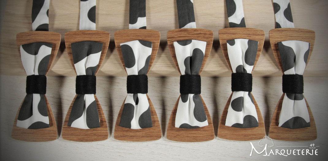 Noeuds papillon bois et tissu taches de vache noir blanc pour service commercial d'une laiterie