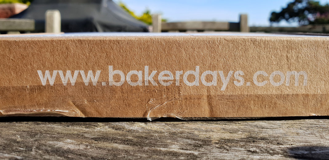 Packaging Bakerdays.com in a brown paper parcel