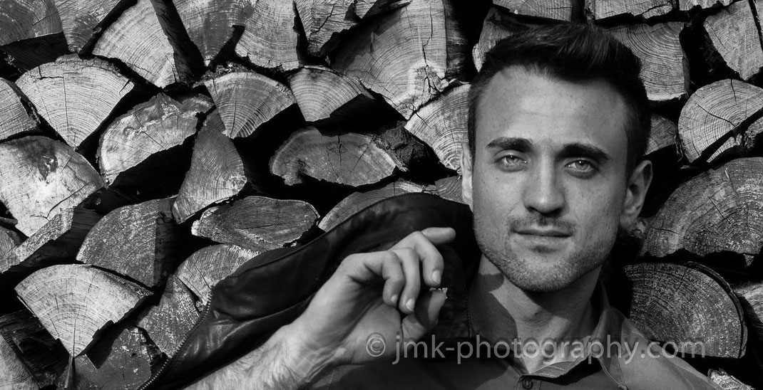 male model on a wood pile, black-white photo