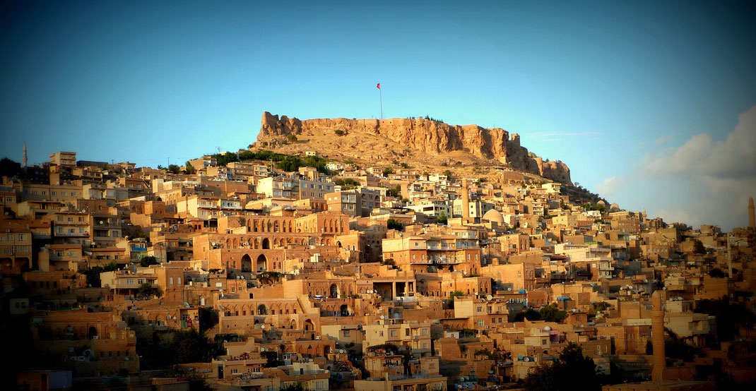 #  Mardin. The city is located on the slope of a hill looking down south to the Mesopotamian plains. According to a hearsay, the history of the city dates as far back as the Flood.