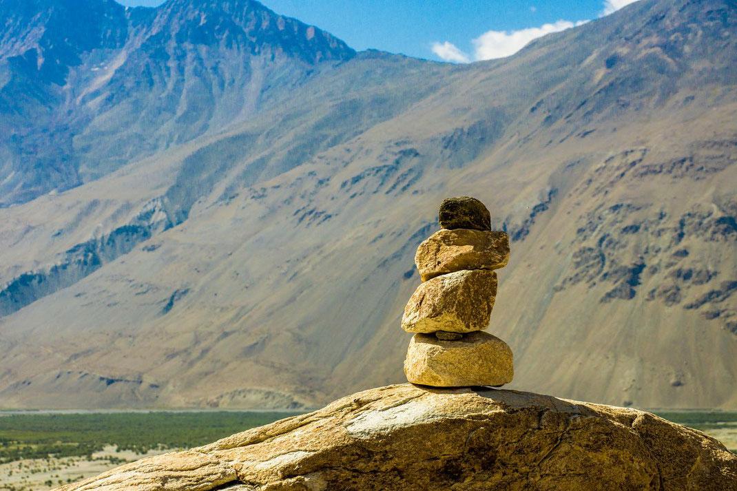 Tajikistan, stone mark on the road to Alichur