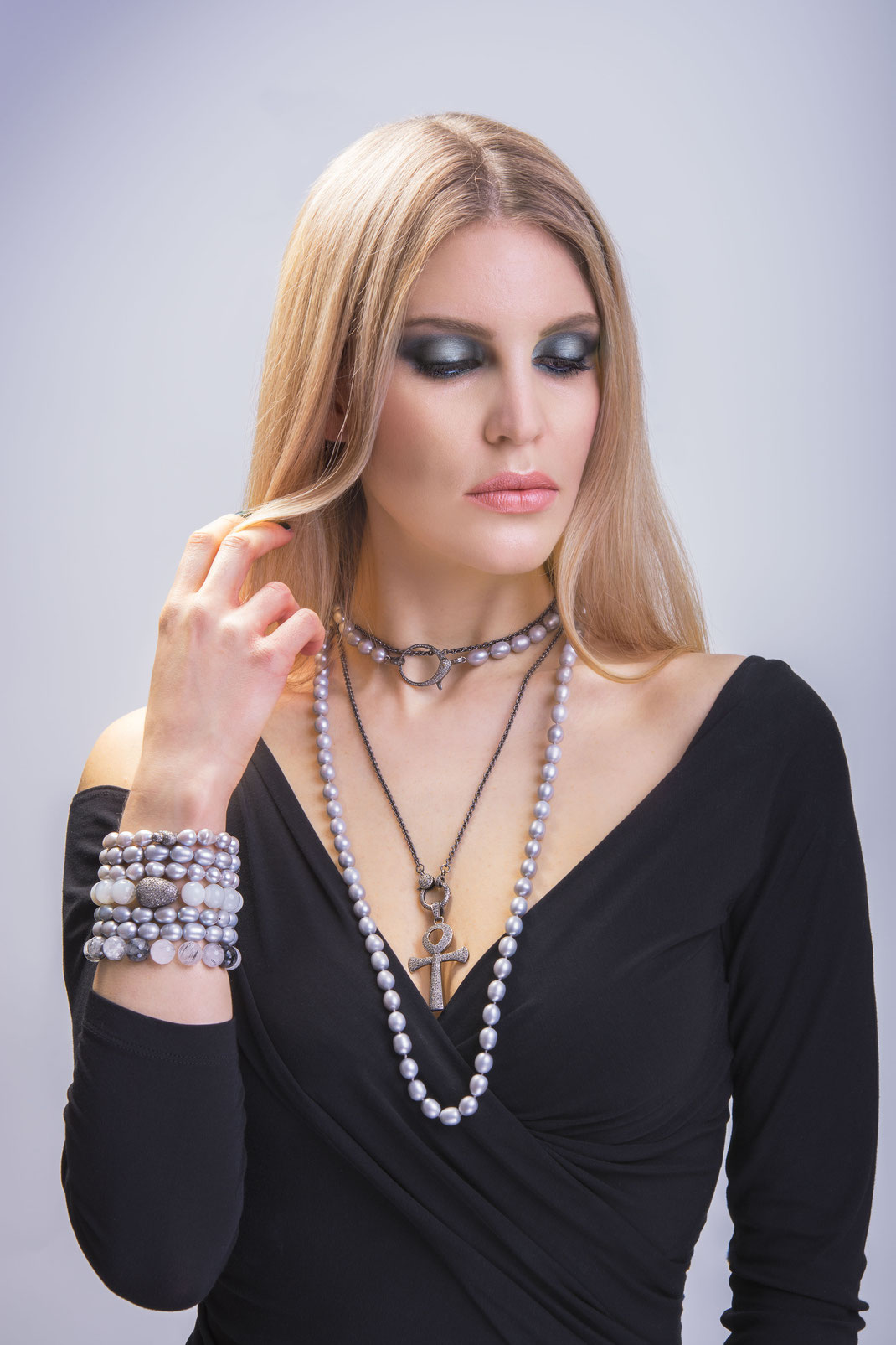 long layered casual elegant pearl and diamond necklace showing edgy but elegant contrasts from grey Sterling and freshwaterpearl