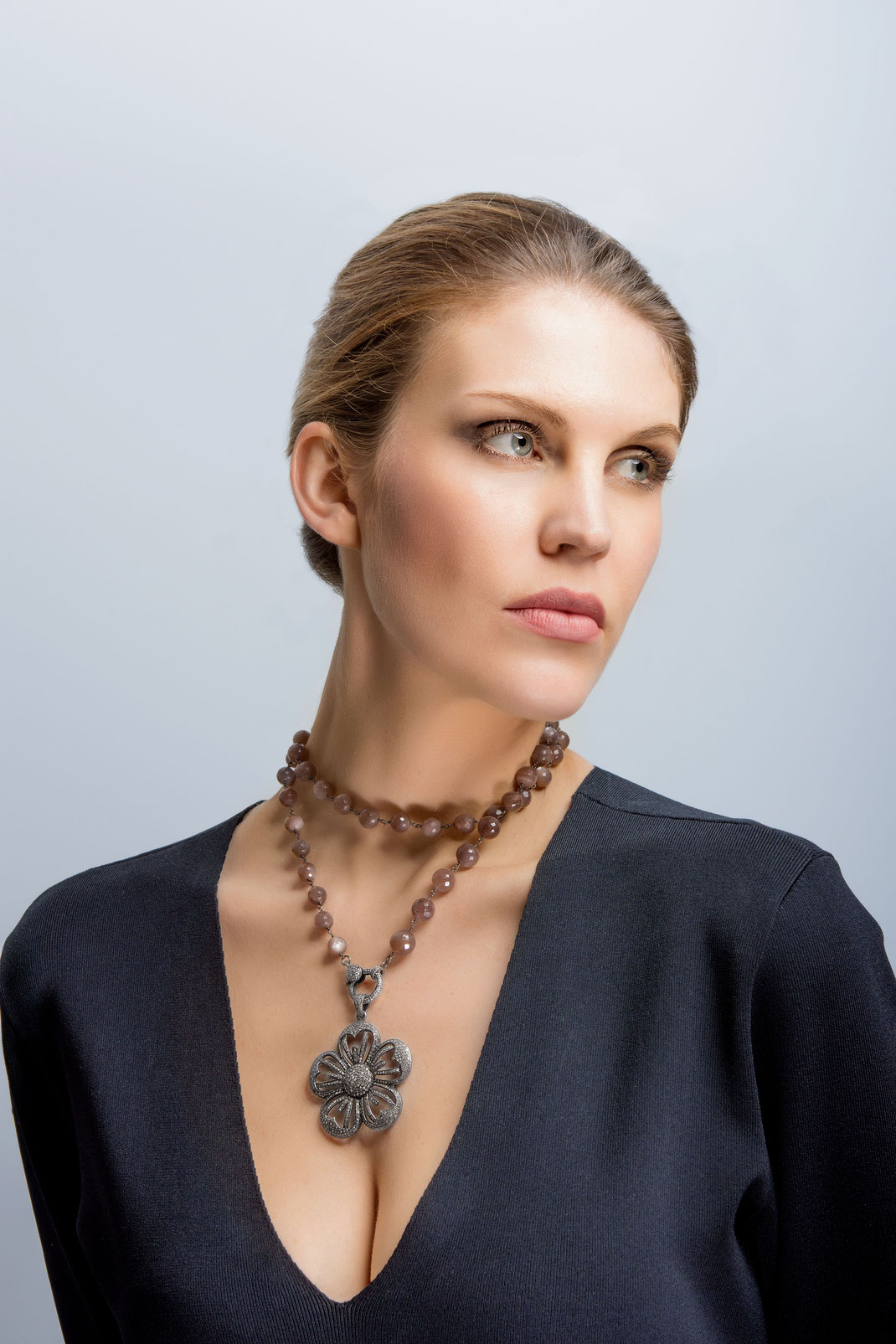 "long necklace wrapped as a choker with a bold diamond pendant ""Flower Carpet"" and a diamond clasp worn in front"