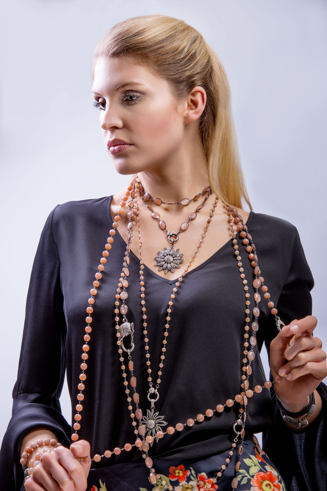 long casual elegant necklaces with grey diamonds and peach moonstone showing a strong boho vibe