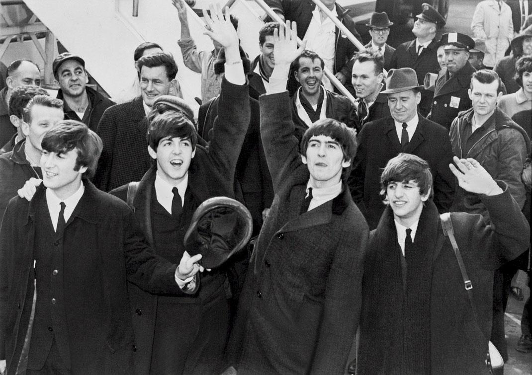 Bild von winkenden Beatles.