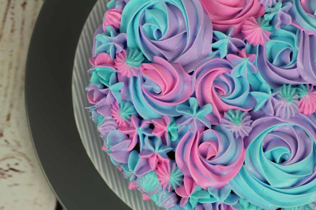 pastel cake with meringue frosting