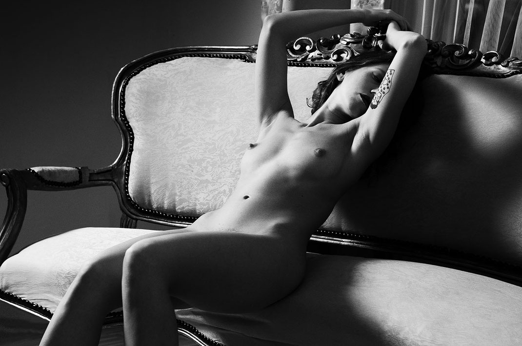 Black and white Fine Art Nude photo with couch by Martin Boelt Photography
