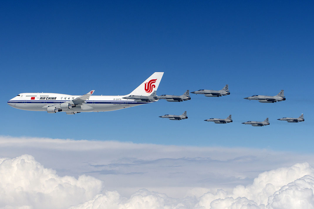 Air China Boeing 747-400 Air Force one escorted by Fighter jets