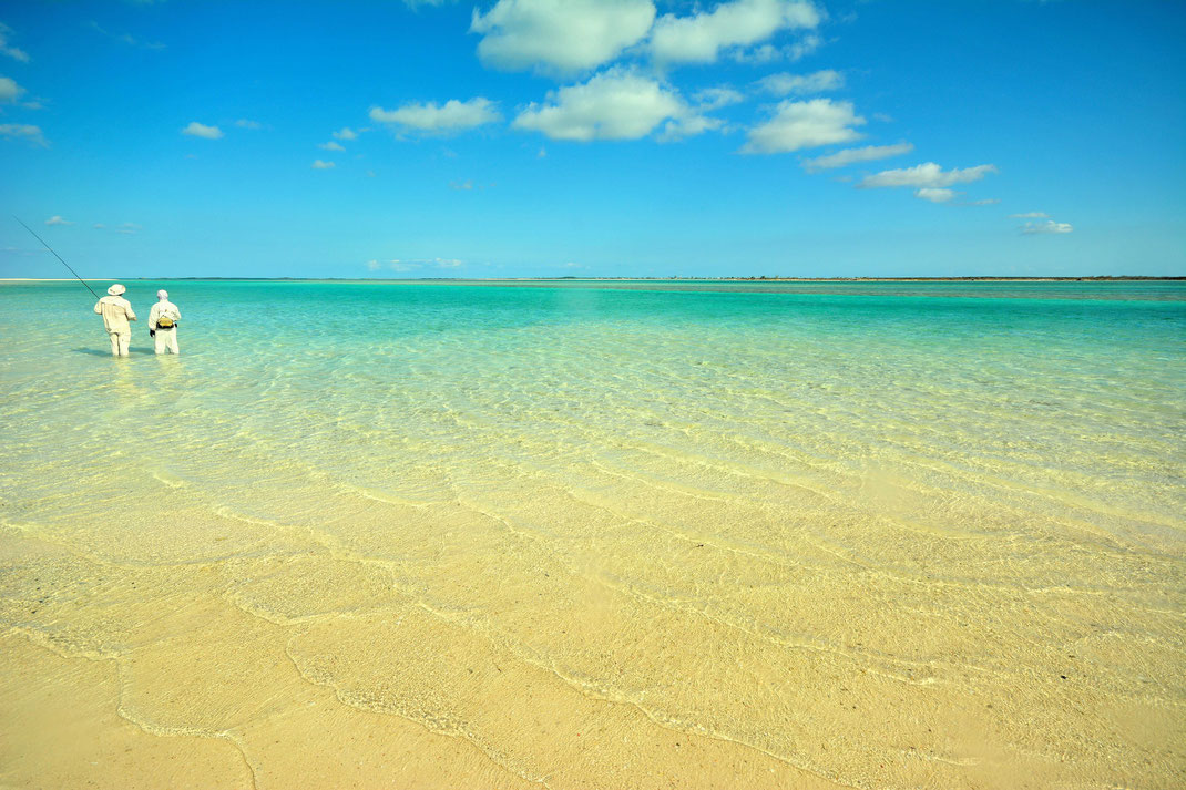 Fly fish Bahamas, FFTC.club saltwater destination, Crooked Island and Acklins, Fly fishermen on the shore, Fly fish saltwater adventure for bonefish, permit, triggerfish, sharks, jacks, barracuda.
