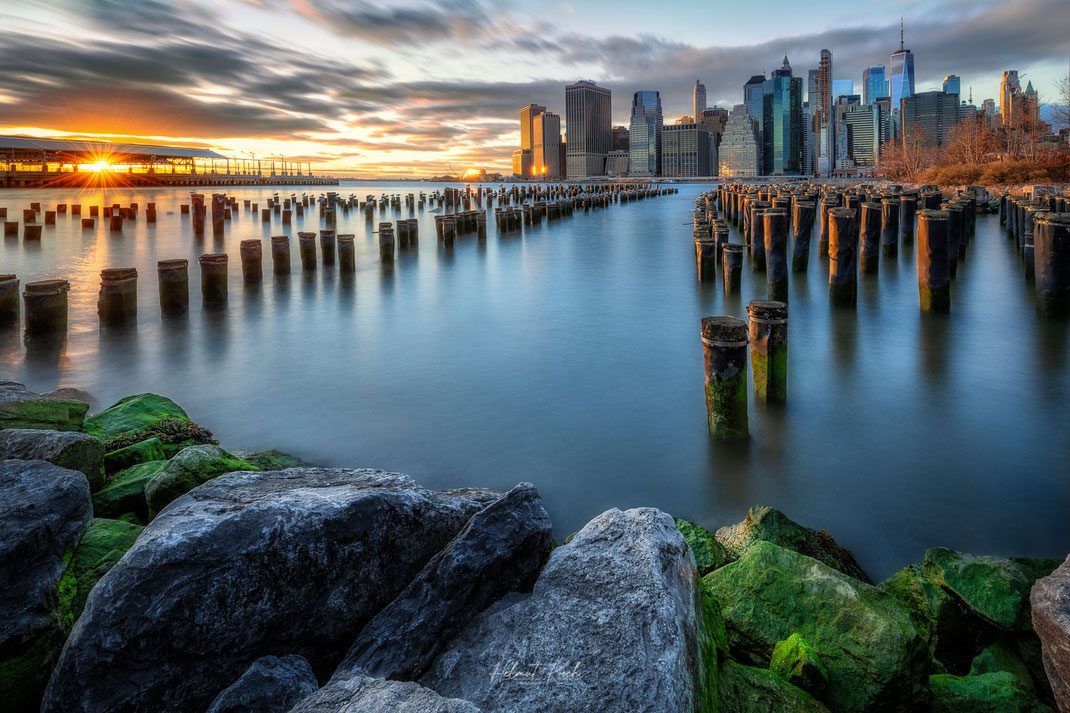 View towards the skyline of Manhattan at sunset from the old pier at Brooklyn Bridge Park