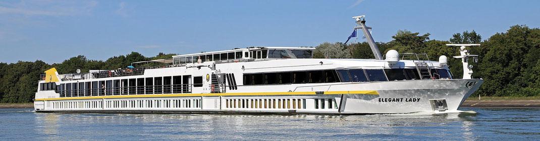 """MS """"Elegant Lady"""" mit französischen Balkon, großen Fenstern für eine helle, geräumige Kabine im Oberdeck während Ihrer Flusskreuzfahrt auf Rhein, der Maas und Donau (c) Plantours Kreuzfahrten"""