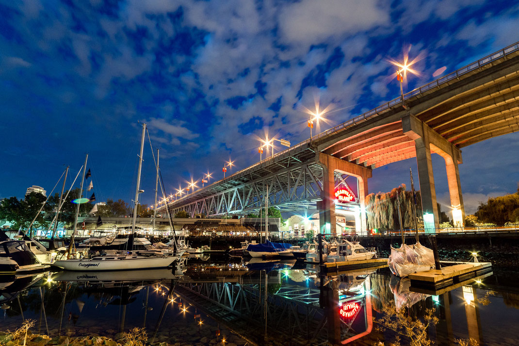 the harbour and entrance to Granville Island at night