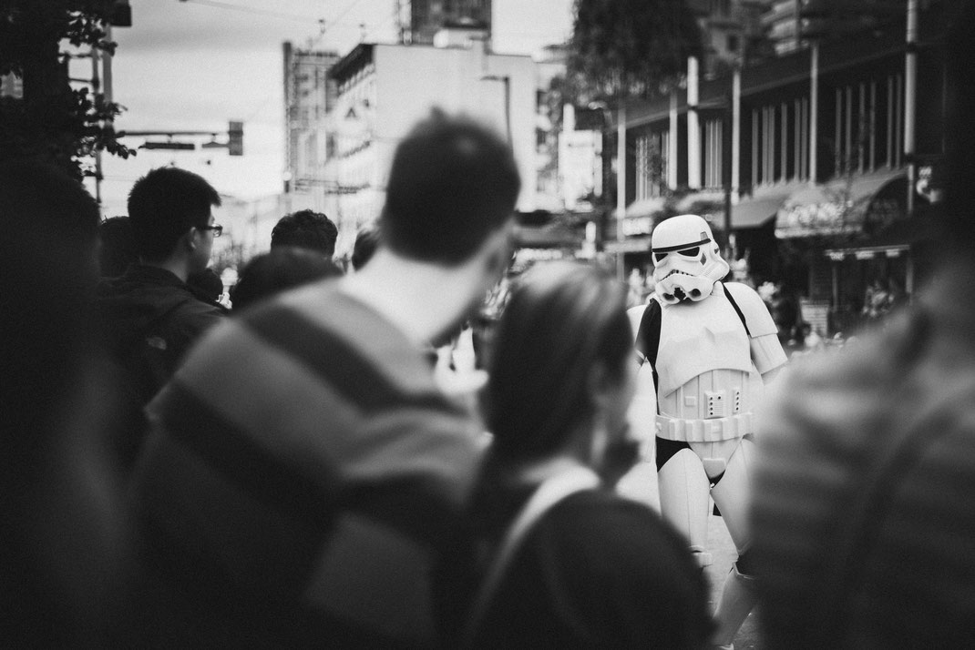a stormtrooper walking on a Halloween parade