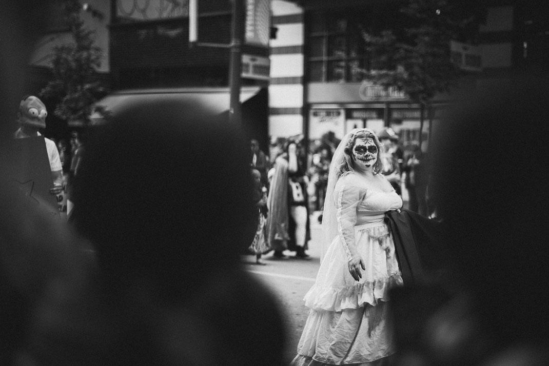 a creepy bride walking down the Halloween parade