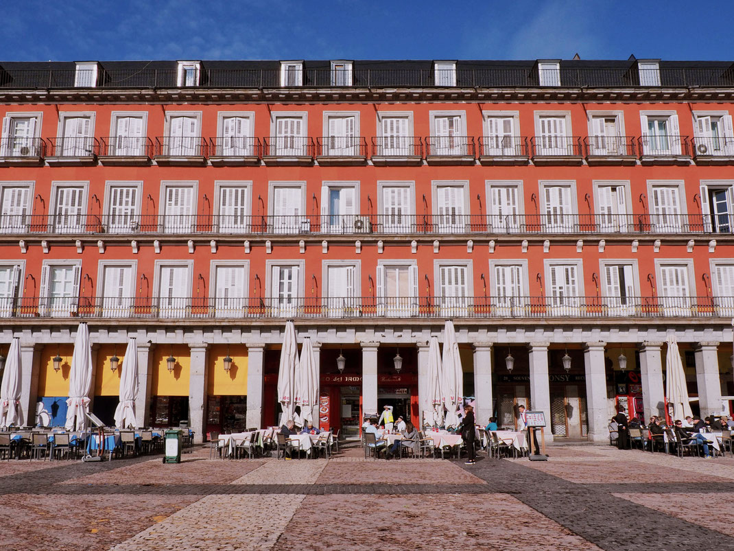 The beautiful red facade of the buildings on Plaza Mayor