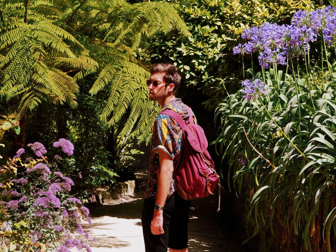 Thomas walking around the gardens
