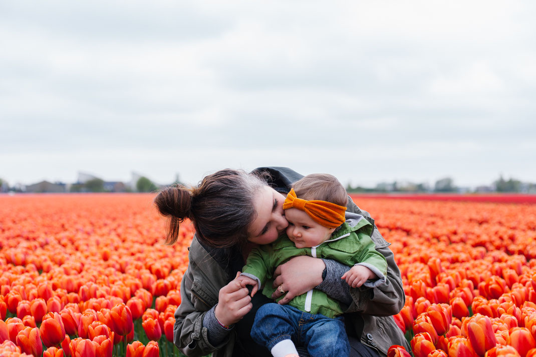 Baby and mom in the tulip fields