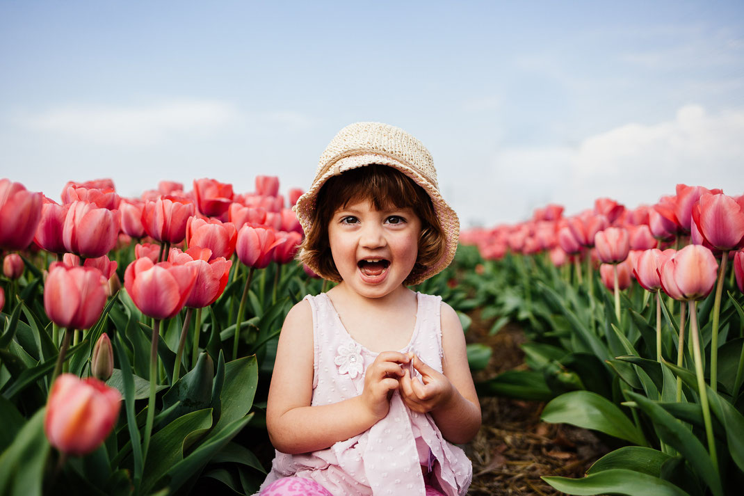 Little girl in the tulip fields