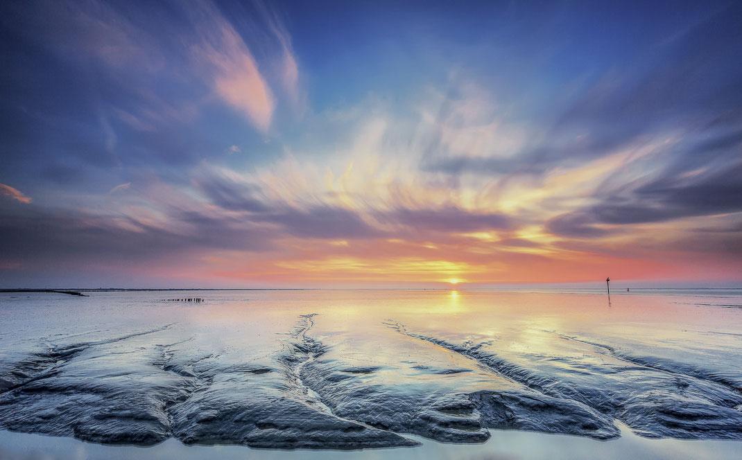 Zonsondergang over het Wad bij Holwerd © Jurjen Veerman