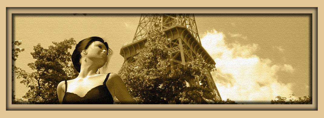 Aktbild eines Mädchens in schwarzen Dessous vor dem Eiffelturm. Auf der Aachener Kunstroute 2016 als Druck auf Aquarellpapier in der Galerie Frutti dell`Arte, Station 20.