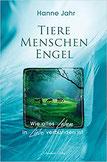 """Bild mit Tieren auf einer grünen, sonnen-durchfluteten Wald-Lichtung. Untertitel: """"Wie alles Leben in Liebe verbunden ist"""""""