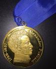 Медаль Пушкинского общества, врученная поэту в 2016 году