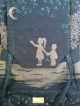 Close up of artwork on custom baby carrier